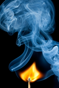 Ignition of match, with smoke on black